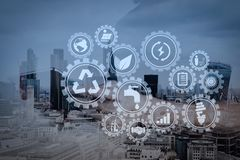 Double exposure of success businessman using digital tablet with. Sustainable development with icons of renewable energy and natural resources preservation with Stock Photo