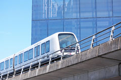 Sustainable driverless modern light rail metro train on railroad track in Europe. Sustainable driverless modern metro train on railroad track in Europe Royalty Free Stock Photos