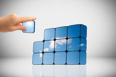 Sustainable growth concept: hand and cubes Royalty Free Stock Photos