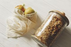 Sustainable lifestyle concept. zero waste. eco natural bags with. Fruits and granola in glass. eco friendly, plastic free items. reuse, reduce, recycle, refuse royalty free stock photo