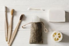 Sustainable lifestyle concept. zero waste flat lay. bathroom essentials, plastic free items. eco natural bamboo. Toothbrush, crystal deodorant,luffa, coconut royalty free stock image