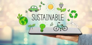 Sustainable with man holding a tablet. Computer royalty free stock image