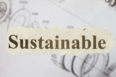 Sustainable. Newspaper cutout with engineering drawing in the background royalty free stock photo