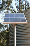 Sustainable Power and Water Vertical. Vertical image of Solar Panel for electricity generation and Tank for water supply. Together they represent self stock photos