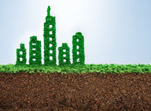 Sustainable urban development. Concept with grass growing in shape of a city Royalty Free Stock Image
