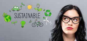 Sustainable with young businesswoman. In a thoughtful face royalty free stock image