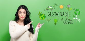 Sustainable with young woman. On a green background royalty free stock photo