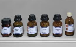 Sustancias químicas en las botellas de cristal Imágenes de archivo libres de regalías