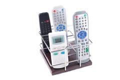 Sustentação sob telefones móveis e controlos a distância fotos de stock