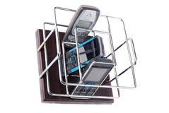 Sustentação sob telefones móveis e controlos a distância fotografia de stock royalty free