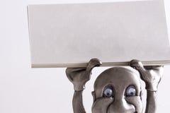 Sustentando o cartão em branco Foto de Stock
