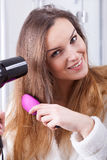 Suszarniczy kobieta włosy Obrazy Stock