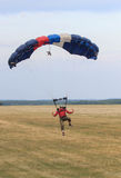 Sutiski, Ukraine - June 24, 2017: Skydivers carries a parachute after landing. Skydive Ukraine is the skydiving center. Located at Sutiski Aerodrome, about 20 Royalty Free Stock Photo