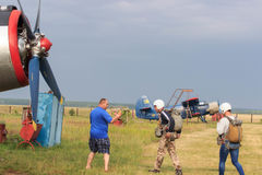 Sutiski, Ukraine - June 24, 2017: Skydivers carries a parachute after landing. Skydive Ukraine is the skydiving center. Located at Sutiski Aerodrome, about 20 Royalty Free Stock Photography