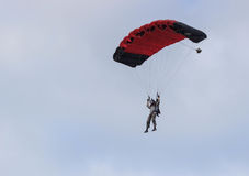 Sutiski, Ukraine - June 24, 2017: Skydivers carries a parachute after landing. Skydive Ukraine is the skydiving center. Located at Sutiski Aerodrome, about 20 Royalty Free Stock Photos
