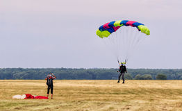 Sutiski, Ukraine - June 24, 2017: Skydivers carries a parachute after landing. Skydive Ukraine is the skydiving center Stock Photo