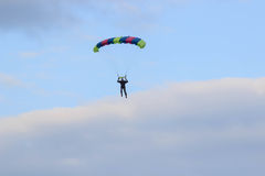 Sutiski, Ukraine - June 24, 2017: Skydivers carries a parachute after landing. Skydive Ukraine is the skydiving center. Located at Sutiski Aerodrome, about 20 Stock Photo