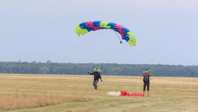 Sutiski, Ukraine - June 24, 2017: Skydivers carries a parachute after landing. Skydive Ukraine is the skydiving center. Located at Sutiski Aerodrome, about 20 Stock Photography