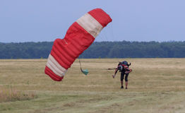 Sutiski, Ukraine - June 24, 2017: Skydivers carries a parachute after landing. Skydive Ukraine is the skydiving center Royalty Free Stock Image
