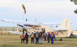 Sutiski, Ukraine - June 24, 2017: Skydivers carries a parachute after landing. Skydive Ukraine is the skydiving center. Located at Sutiski Aerodrome, about 20 Royalty Free Stock Image