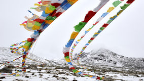 Sutra streamers below snow mountain Stock Photos