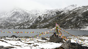Sutra streamers and lake below the snow mountain Stock Images