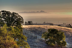 Sutter Buttes Sunrise. Sunrise on the Sutter Buttes from the Eastern foothills of the Northern Coastal Range of California Stock Image