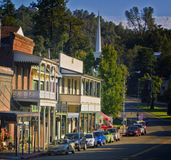Sutter Creek, California. Buildings catch the late afternoon light on the main street in Sutter Creek, in Amador County, a quaint historic town and tourist Stock Photos