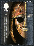Sutton Hoo Helmet UK Postage Stamp. GREAT BRITAIN - CIRCA 2003: A used postage stamp from the UK, depicting an image of a Sutton Hoo Helmet exhibited in the Royalty Free Stock Photos