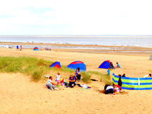 Sutton-on-Sea sands, Lincolnshire. Families enjoying a day on the sands at Sutton-on-Sea, Lincolnshire, England, UK Stock Photos