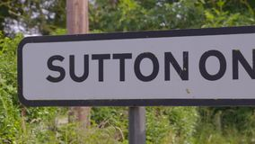 Sutton on Trent signage standing along a busy road