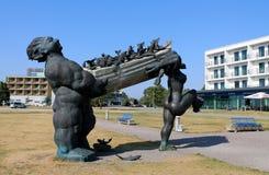 Suur Tyll - Hero of Estonian mythology sculpture. ESTONIA, KURESSAARE / AUGUST 6 / 2014 - Sculpture of the Estonian mythology hero Suur Tyll and his wife Piret Stock Photography