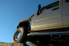 SUV ascendente Imagenes de archivo