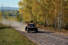 SUV in the autumn forest stock photography