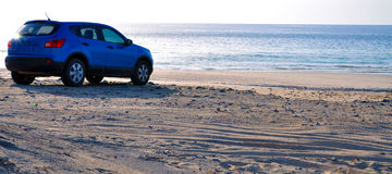 SUV on the Beach (a) Royalty Free Stock Photo