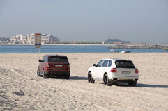 SUV on the beach in Dubai Stock Photo