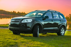 SUV. Black car with sunset background stock images