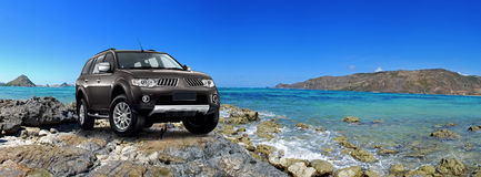 Suv car on beach Royalty Free Stock Image