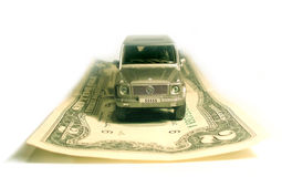 A SUV Car and A Dollar. Expensive SUV car on the dollar shows the way of luxury lifestyle Stock Photo