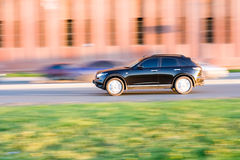 Suv car drives on road at speed Stock Photography