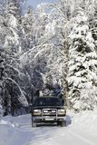 Suv, car, driving in snowy country Stock Photos