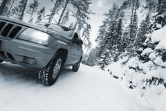 Suv, car, driving in snowy dangerous conditions Royalty Free Stock Photo
