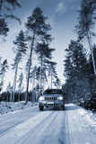 Suv, car driving on snowy road Royalty Free Stock Image