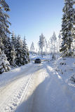 Suv, car, driving in winter landscape Stock Photography