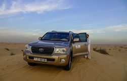 A SUV car on Dubai desert stock photography