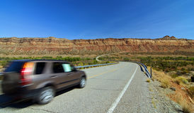 SUV car entering monument valley, utah Stock Photos