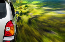 SUV car in forest. Silver SUV driving fast through the forest Royalty Free Stock Photos