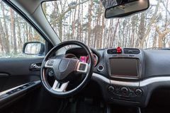 SUV car interior. Parked at the forest Stock Photo