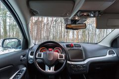 SUV car interior. Parked at the forest Stock Image