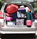 SUV car with many luggage on the ground and in the luggage. Before leaving Royalty Free Stock Image